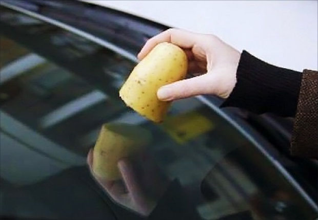 Cleaning windscreen with a potato
